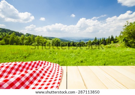 Empty table with landscape background - stock photo
