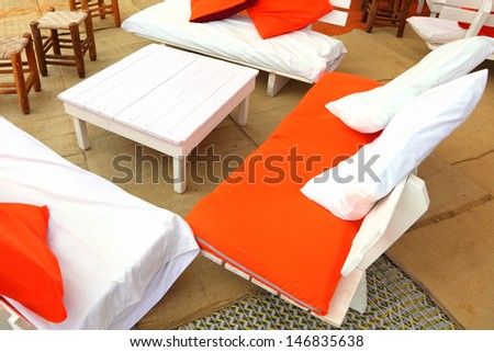 Empty tables and chairs in seaside cafe - stock photo