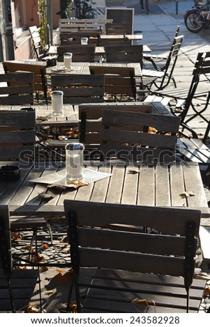 empty tables outside a restaurant in Berlin - stock photo