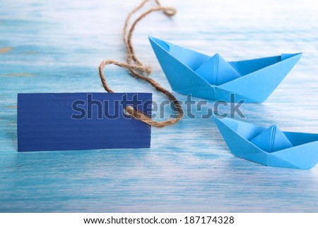 Empty Tag with Copy Space and two Boats in the Background - stock photo