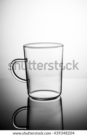 Empty Tea cup on a white gradient background, front view