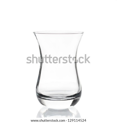 Empty tea glass isolated on white background