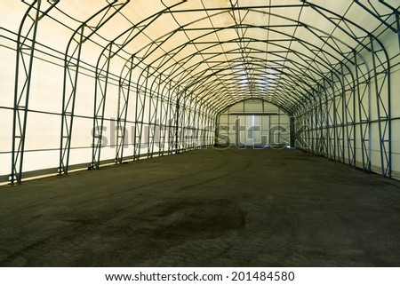 Empty tent warehouse interior   - stock photo