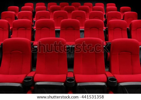 Empty theater auditorium or cinema with red seats - stock photo