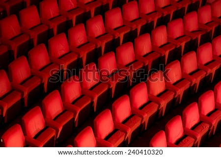 Empty theater with red chairs. Top view. - stock photo
