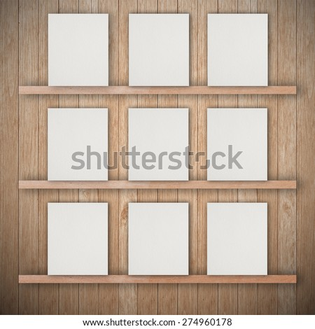 Empty three wood shelf and empty paper - stock photo