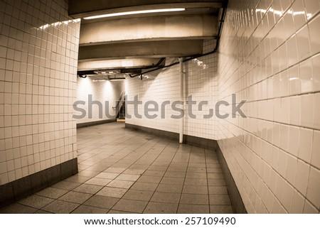 Empty tiled underground corridor  - stock photo