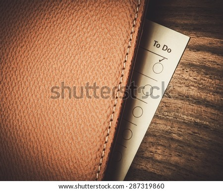 Empty to do list on wooden table  - stock photo