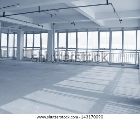 Empty to interior decoration ,An empty warehouse   - stock photo