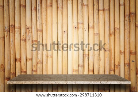 Empty top of natural stone shelves and bamboo wall background. For product display - stock photo