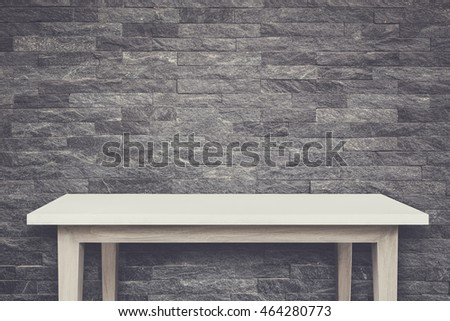 Empty top of natural stone table and stone wall background. For product display. Retro and vintage style