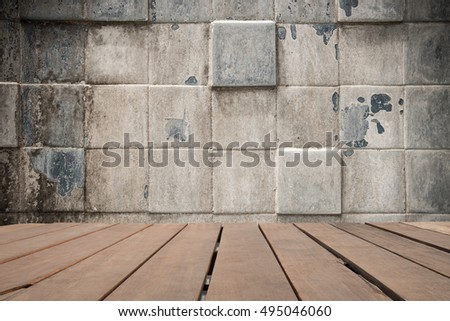 Empty top of natural wooden shelves on ceramic blue tile wall background
