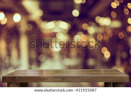 Empty top of natural wooden table and blur with bokeh background. use for product display