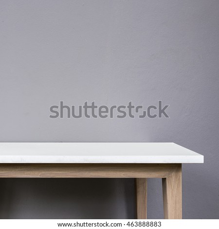 Empty top of white mable stone table on grey wall background. For product display