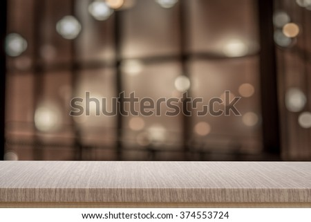 Empty top of wooden table or counter on cafeteria, bar, coffee shop background. For product display - stock photo