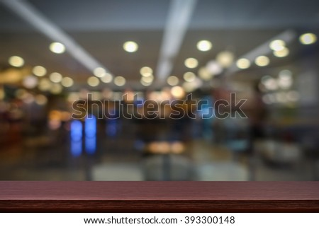 Empty top of wooden table or counter on cafeteria, bar, coffeeshop background. For product display - stock photo