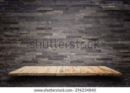 Empty top wooden shelves and stone wall background. For product display  - stock photo