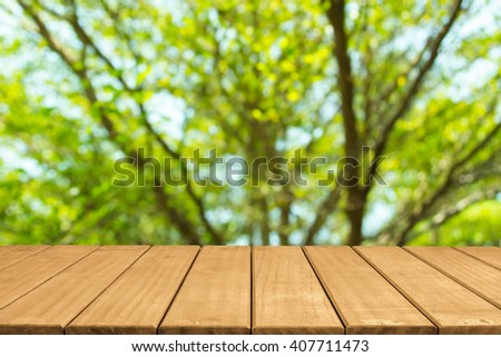 Empty top wooden table and blurred green nature bokeh background
