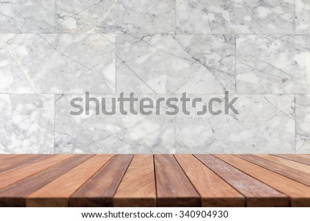 Empty top wooden table and natural stone wall background. For product display - stock photo