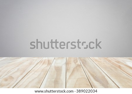 Empty top wooden table and natural stone wall background. For product display