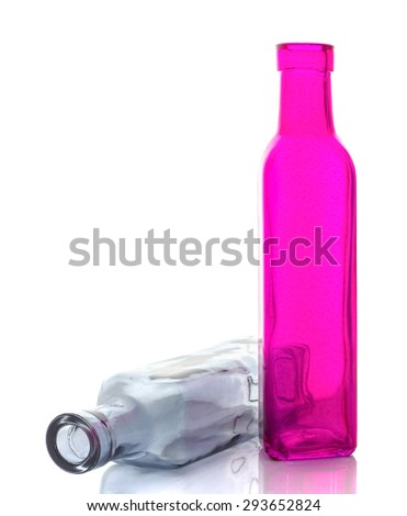 Empty transparent  and pink glass bottle isolated on a white background - stock photo