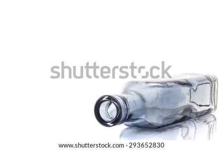 Empty transparent glass bottle isolated on a white background - stock photo