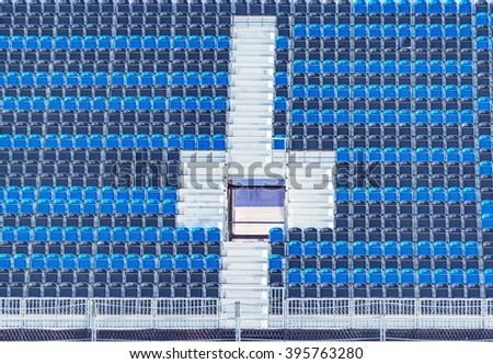 Empty tribune of the soccer stadium with entrance. - stock photo