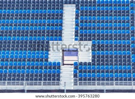 Empty tribune of the soccer stadium with entrance. - stock photo
