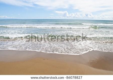 Empty  tropical beach and clear blue sky - stock photo