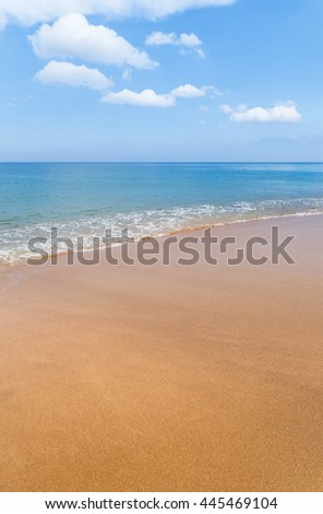 Empty tropical beach and sea with white cloud and blue sky background in Thailand