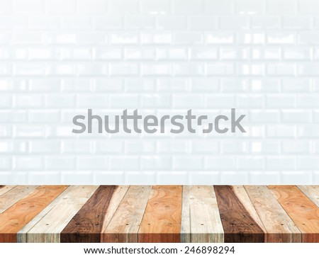 Empty tropical wood table and blur white ceramic tile brick wall in background,Mock up template for display of your product - stock photo