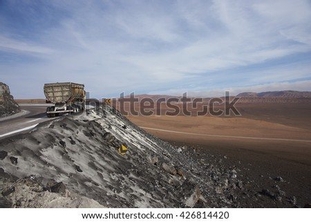Empty truck heading towards the salt mines in the Atacama Desert in northern Chile. The salt is extracted from vast salt lakes and taken to the coast for transportation overseas. - stock photo