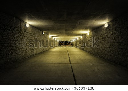 Empty Tunnel with yellow light at night