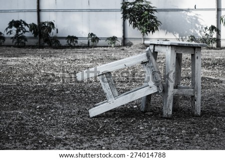 Empty two white wooden chair outdoors - stock photo