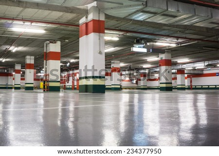 Empty Underground Parking Garage - stock photo
