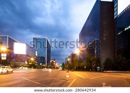 Empty urban road and modern skyline - stock photo