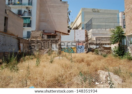 Empty urban space where apartment building block was demolished. - stock photo