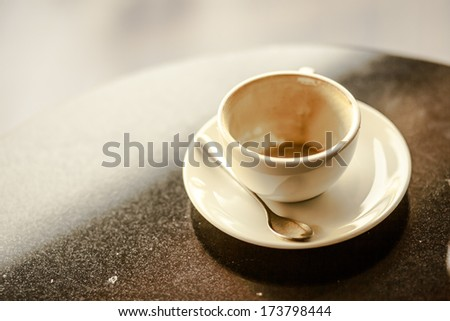 empty used coffee cup on table - stock photo