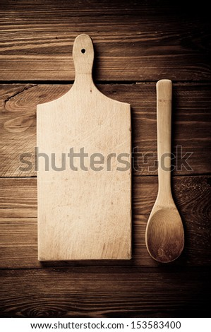 Empty vintage cutting board on planks food background concept - stock photo