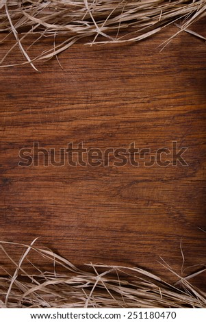 Empty vintage wooden rustic cutting board with straw, free copy space for your text - stock photo
