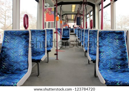 Empty wagon of a metro train with blue seats - stock photo
