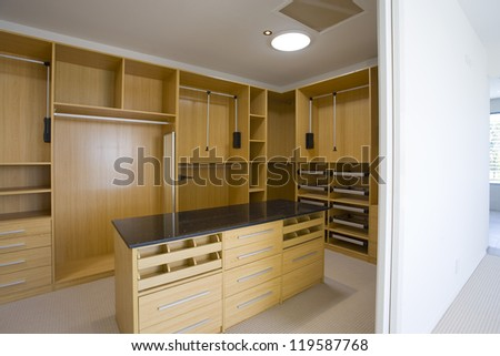 Empty walk in robe in mansion - stock photo