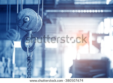 empty warehouse interior with crane hook - stock photo