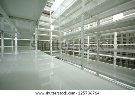 Empty warehouse racks, Empty metal shelf in storage room, storage concept - stock photo