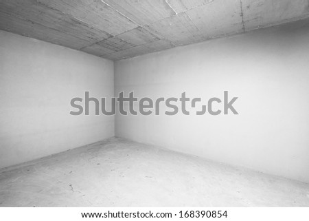 Empty warehouse room with concrete walls and floor. - stock photo