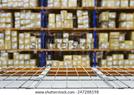 Empty warehouse shelves with defocused background on racking - stock photo