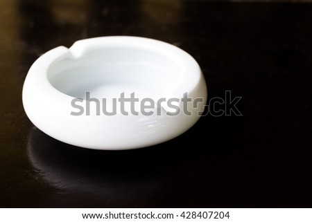 empty white ashtray on table