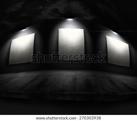 Empty white billboard panels in front of long brick wall with spotlights  - stock photo