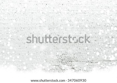 empty white brick wall with snowing ,Ready for product display montage. - stock photo