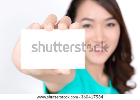 Empty white business card shown by smiling young woman